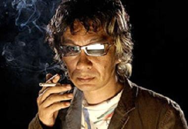 Takashi Miike smoking a cigarette (or weed)