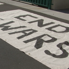 "The 35-member San Diego chapter of Veterans for Peace displayed banners Thursday afternoon that read ""End the wars"" and ""Vets for peace"" along the Sixth Avenue bridge over Interstate 5."