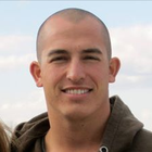 Sgt. Andrew Tahmooressi was arrested six months ago at a San Diego-Tijuana checkpoint after Mexican officials say they found three guns in his pickup truck. He said he mistakenly wound up at the border crossing when headed to dinner in San Ysidro.