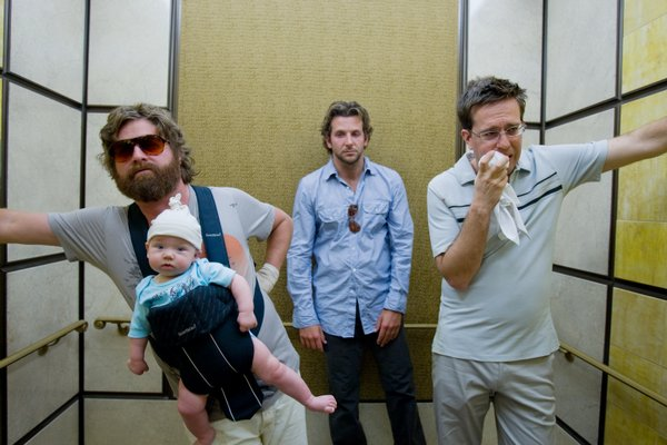 "Zach Galifianakis, Bradley Cooper, and Ed Helms are three men and a baby in Vegas in ""The Hangover"""
