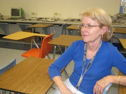 Veteran teacher Carol Guerrero sits in her classroom at Montgomery High School -- one of 32 campuses in the Sweetwater Union High School District. She questions the direction and leadership of the district's current administration.