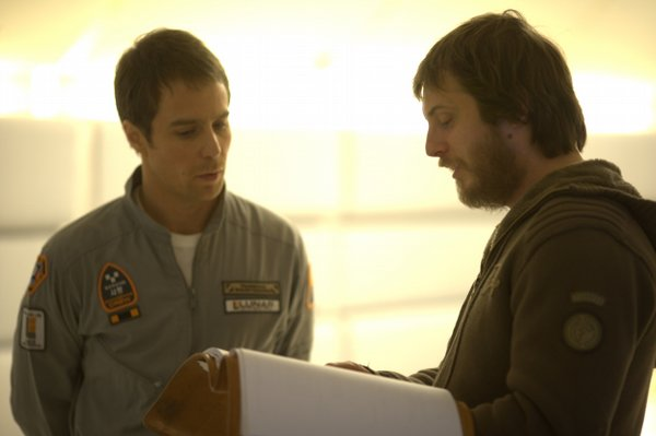 "Actor Sam Rockwell with director Duncan Jones on the set of ""Moon"""
