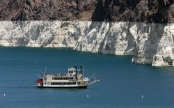 The white 'bathtub ring' on the rocks around Lake Mead is from mineral deposits left by higher levels of water.