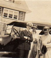 George Leo Compo, Jean Scott Bergner and Mrs. Mayes in front of car.