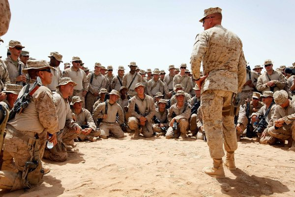 U.S. Lt. Col. Christian Cabaniss speaks to his Marines at Camp Dwyer on July 1, 2009 in Helmand Province, Afghanistan. The Marines are part of a stepped up effort by American troops fighting Taliban fighters in Southern Afghanistan.