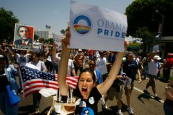 (File photo) Gay pride participants hold signs in support of Democratic presidential hopeful Barack Obama at the 38th annual LA Pride Parade June 8, 2008 in West Hollywood, California. 