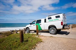 Border Patrol vehicle overlooking Border Field State Park in Imperial Beach.