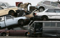 Junk cars are seen stacked at Deal Auto Wrecking July 31, 2009 in Richmond, California. Federal lawmakers are seeking an additional $2 billion to keep the popular &#39;Cash For Clunkers&#39; program going after the initial $1 billion in funding ran out after a week.