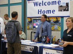 "A veteran gets information at a booth at the the ""Welcome Home"" event in La Jolla. With a new GI Bill in effect, many veterans attended the event to get answers of their new benefits."