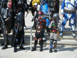 Young children show-off their bounty hunter costumes at San Diego Convention Center.