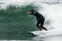 Surfer Jaimal Yogis rides a wave. Yogis is also a journalist and writer with a new book about the lessons of Zen Buddhism and surfing.