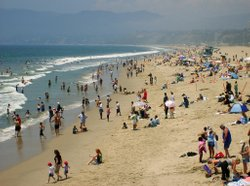 People head to the beach to escape the heat in Santa Monica in July 2006.