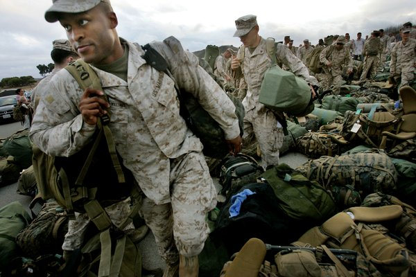 Marines pick up their belongings during a homecoming ceremony on October 4, 2008 at Camp Pendleton in Oceanside, California.