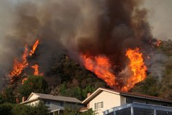 Flames approach homes in La Crescenta, California. The out of control Station Fire has burned more than 105,000 acres and has forced thousands of evacuations as nearly 12,000 homes are threatened.