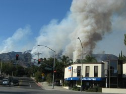 Backfires burn fiercely on Monday afternoon next to homes in the La Crescenta area of Los Angeles. The backfires are intended to stop the spread of the fire.