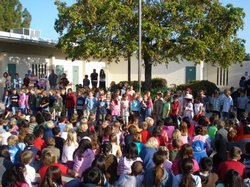 Elementary students from a San Diego Unified school attend an assembly in the school&#39;s courtyard.