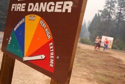 A sign displays current fire danger as extreme in Southern California.