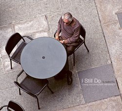 Judith Fox's book of photography captures her husband, Edmund Ackell, as he lives with Alzheimer's disease. On this book cover, Judith gets a bird-eye's view as Edmund sits alone at a table in a courtyard.