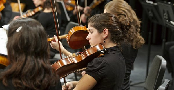 Salwa Bachar, a member of the San Diego State University Symphony Orchestra, plays the viola.