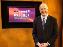 "Dr. James S. Gordon, pictured here in the KPBS's studios, works with people throughout the world who have been traumatized by war and violence. His ""Unstuck"" techniques can help anyone reduce stress and improve their health."