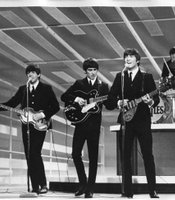 "The Beatles made their American television debut in 1964 on ""The Ed Sullivan Show."" The Fab Four perform their million-selling #1 chart debut ""I Want to Hold Your Hand,"" followed by another smash, ""She Loves You."""