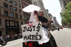 A couple on their motorcycle make a statement about the contentious issue of gay marriage while participating in the annual New York City Gay Pride March on June 28, 2009 in New York City. The year&#39;s march commemorates the 40th anniversary of the Stonewall riots.
