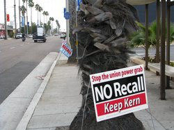 A sign opposing the recall of councilman Jerry Kern stands on an Oceanside street.