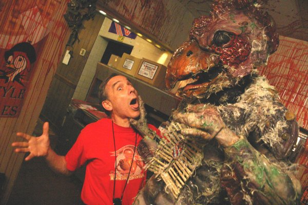 Lloyd Kaufman and friend.