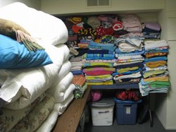 Donated comforters and towels in the storeroom at the winter shelter for homeless families in Vista. Volunteers try to send families off with a full set of bedding when they leave the shelter for transitional housing or their own rental unit. They are always short on pillows.