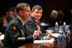 Commander of the International Security Assistance Force and Commander of U.S. Forces Afghanistan Gen. Stanley McChrystal (L) and U.S. Ambassador to Afghanistan Karl Eikenberry (R) testify during a hearing before the House Armed Services Committee December 8, 2009 on Capitol Hill in Washington, DC.