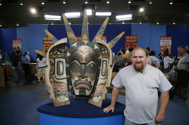 "An over-sized, Northwest Coast Indian-style dance mask, carted to ""ROADSHOW"" by its hopeful owner. Appraiser John Buxton admires the decorative piece, but regretfully points out the mask would be too big and heavy to use in a dance — and actually is a reproduction with a value of $1,500 to $2,000."