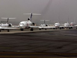 Airplanes line up as they await their turn to take off at Newark International Airport in New Jersey, February, 2008.