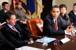 Flanked by Secretary of the Treasury Timothy Geithner (L) and senior advisor Valerie Jarrett, President Barack Obama speaks during a meeting with CEOs of several small and community banks December 22, 2009 in the Roosevelt Room at the White House in Washington, DC.