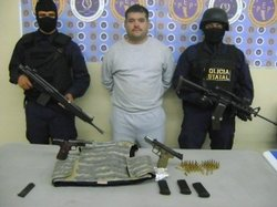 Baja California&#39;s Preventive arrested 29-year-old Luis Gilberto Snchez Guerrero on December 29, 2009. He is seen here along with weapons and ammunition confiscated in the arrest.