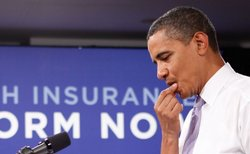 U.S. President Barack Obama pauses during a town hall meeting on healthcare at the headquarters of the Democratic National Committee August 20, 2009 in Washington, DC. Obama answered questions from people on his plan for healthcare reform during the town hall.