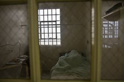 A sick prisoner sleeps in the hospital unit at the California Medical Facility in Vacaville.