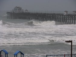 Large surf caused by a series of storms to hit Southern California slams the Oceanside Pier on January 20, 2010.
