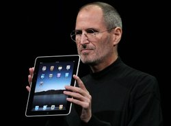 Apple Inc. CEO Steve Jobs holds up the new iPad as he speaks during an Apple Special Event at Yerba Buena Center for the Arts January 27, 2010 in San Francisco, California. Apple introduced its latest creation, the iPad, a mobile tablet browsing device that is a cross between the iPhone and a MacBook laptop.