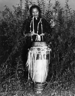 Zora playing drum in a photo in the New York Herald Tribune.