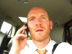 A driver uses a cell phone while driving to Seattle in August 2008.