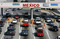 Traffic in the U.S. enters Mexico at the San Ysidro border crossing, the world's busiest, on June 27, 2008 in Tijuana, Mexico.