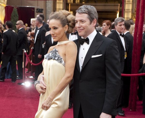 You cannot appreciate the full awfulness of Sarah Jessica Parker's dress in this photo but trust me it was a fashion disaster with some odd adornment on the back of the dress just below her butt.