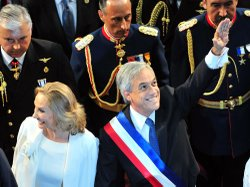 Chilean President Sebastian Piñera, accompanied by his wife, Cecilia Morel, waves during his inauguration ceremony at the Congress in Valparaiso.