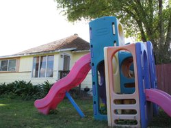 A playground sits on a spacious front lawn of Becky Sangha's Escondido home.