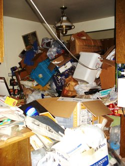 "Piles of ""stuff"" are heaped throughout this hoarder's house."