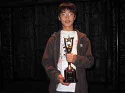 Alex Kahng, 14, holds up his trophy after spelling his way to victory in the San Diego County Spelling Bee Championship at the Old Town Theater on March 25, 2010.