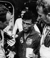 South Vietnamese pilot Bung Ly may have been in shock after landing his tiny observation plane aboard the USS Midway. His wife sat in the backseat of his aircraft, holding an infant, and four other children were crammed inside the luggage compartment.