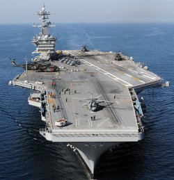 The Nimitz-class aircraft carrier USS Carl Vinson (CVN 70) awaits the return of Carrier Air Wing (CAG) 17 aircraft along the coast of Haiti. Carl Vinson and Carrier Air Wing (CVW) 17 arrives on January 15, 2009 in Port-Au-Prince, Haiti.  /U.S. Navy via Getty Images)