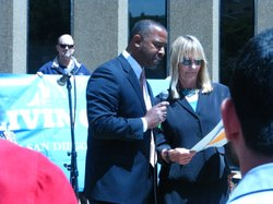 Councilmembers Donna Frye and Tony Young read the proclamation to celebrate the fifth year of the city's Living Wage Ordinance.