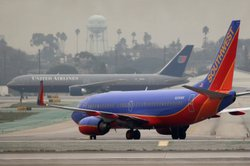 United Airlines and Southwest Airlines jets taxi at Los Angeles International Airport on December 21, 2009.